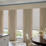 White Graber Solar Shades with Drapes and Valance