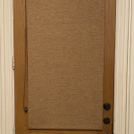 Roller Shades that match the wood is one nice option for front door privacy.